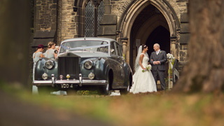 Saddleworth church wedding, bride with proud father and bridesmaids outside Friezland Church, Greenfield