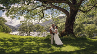 Snodonia wedding - under the tree with Llyn Gwynant in the background.