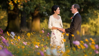 Wedding photograph at Roundhay Park, Leeds with colourful wild flowers.